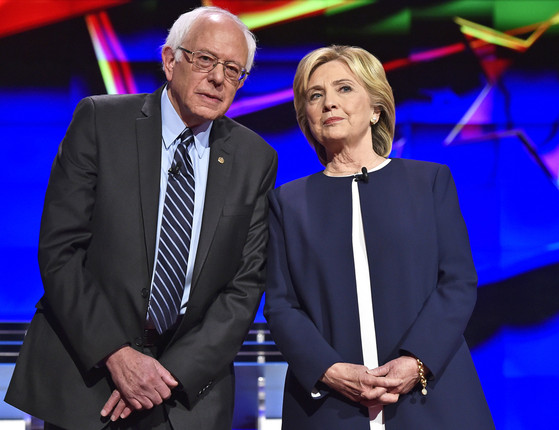 Democratic presidential candidates Sen. Bernie Sanders, of Vermont, left, and Hillary Rodham Clinton talk before the CNN Democratic presidential debate Tuesday, Oct. 13, 2015, in Las Vegas. (AP Photo/David Becker)